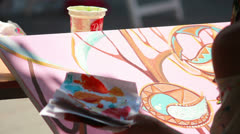 Artist paints pict Stock Footage