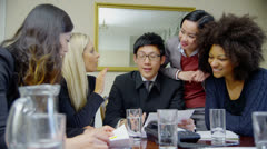Attractive, diverse business team in a meeting  Stock Footage