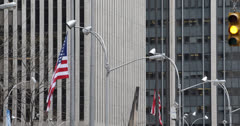 Ultra HD 4K American Flag in Front of Business Building, Corporate Skyscrapers Stock Footage