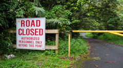 Rain forest road closed authorized personnel Stock Footage