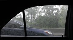 Looking Out Into Rain From Backseat of Vehicle Stock Video Stock Footage
