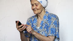 Old woman using smartphone Stock Footage