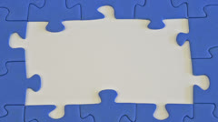 Building a jigsaw of blue pieces Stock Footage