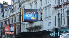 Shaftsbury Avenue, show posters in London Stock Footage