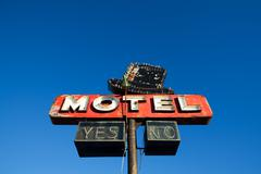 Motel sign against blue sky Stock Photos