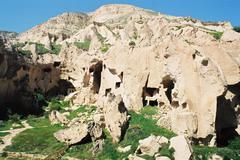 Cave dwellings in Cappadocia in Turkey - stock photo