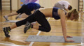 Plank position workout in gym. Knees to chest exercise HD Footage