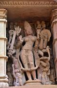 Kamasutra, carvings on temple walls at Khajuraho - stock photo