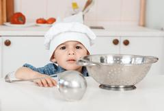 Portrait of a little chef hat and apron - stock photo