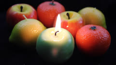 Romantic light from fruit candles Stock Footage