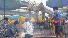 Tourists visit 'Pra Prum' to get a good luck at Era-wan junction in Bangkok Stock Footage
