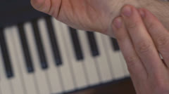 Musician with Carpal Tunnel Syndrome Massages Wrist - stock footage
