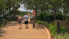 People in Theme Park Walking Along Pathway Stock Footage