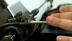 Woman's hands preparing an old typewriter. 2 shots Stock Footage