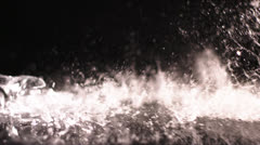 Champagne glass falls and shatters in slow motion against black background Stock Footage