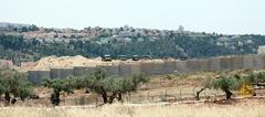 israeli army by the wall of separation - stock photo
