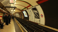 Underground tube arrives, London (1) - stock footage
