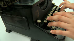 Close-up of woman's hands typing a text on an old typewriter ribbon. Stock Footage