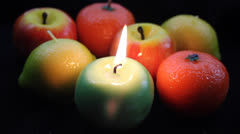 Colorful fruit candles Stock Footage