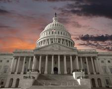 dawn sky over the united states capitol in washington dc - stock photo