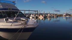 Motor Cruiser at Dock in Harbor Stock Footage