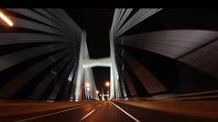 Time lapse drive across bridge thru town Stock Footage