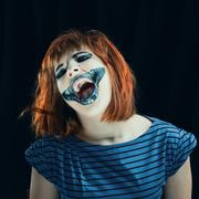 halloween face art on black background - stock photo
