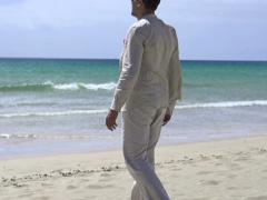 Happy, excited man relaxing on beach, super slow motion, shot at 240fps NTSC Stock Footage