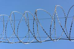 Barbwire on sky background Stock Photos