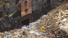 Stream creek goes into intake-tube-water drain Stock Footage