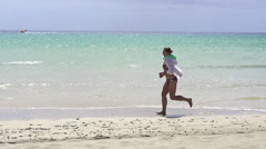 Woman jogging on beautiful topical beach HD Stock Footage