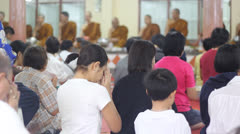 BANGKOK,THAILAND - JAN 2013 : Buddhist monk pray to crowd in the temple Stock Footage