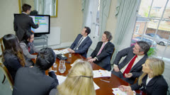 Attractive, diverse team of professionals in a meeting around a conference table Stock Footage