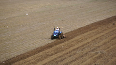 Tractor plowing the spring field (05) Stock Footage