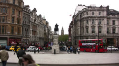 View towards Whitehall from Trafalgar square with Red London bus passing - stock footage