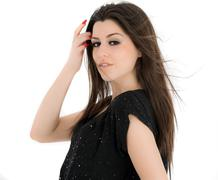 beautiful woman with long brown hair.pportrait of a fashion model posing at s - stock photo