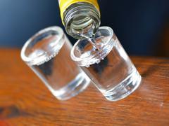 Alcohol poured into a glass Stock Photos