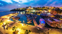 Timelapse of an old harbor in Antalya, Turkey at night Stock Footage