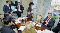 Time lapse of a business team in a meeting around a conference table Stock Footage