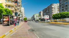Timelapse of people waiting for city transport at bus stop in Antalya, Turkey 4k Stock Footage