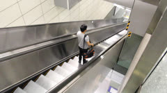Man standing on escalator and going downstair at subway in Bangkok Stock Footage