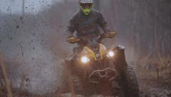 Sports quad bike ride in the woods on a dirt Stock Footage