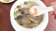 Thai congee with prawn and mushroom for breakfast Stock Footage