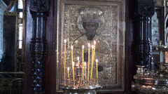 Saint Nicolas Icon and Candles. Orthodox Church Stock Footage