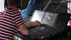 Sound producer at mixer during a concert - stock footage