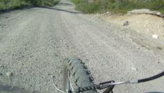 Mountain biker - view from handlebars Stock Footage