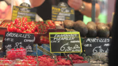 Buying Tomatoes and Rasberries Stock Footage