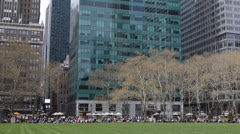 Business Corporate People enjoying a nice day in One Bryant Park, New York City Stock Footage