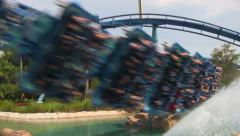 Rollercoaster Flying By Through Water with Screaming Sound Stock Footage