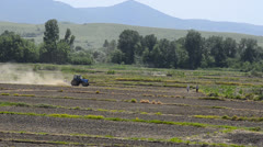 Tractors machine plow and preparing land for sowing. Stock Footage